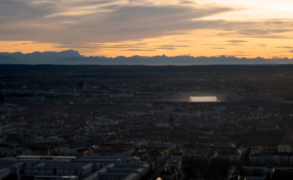 The resonance from far away in the cityscape. In the background you can see the sunset and the Alps.