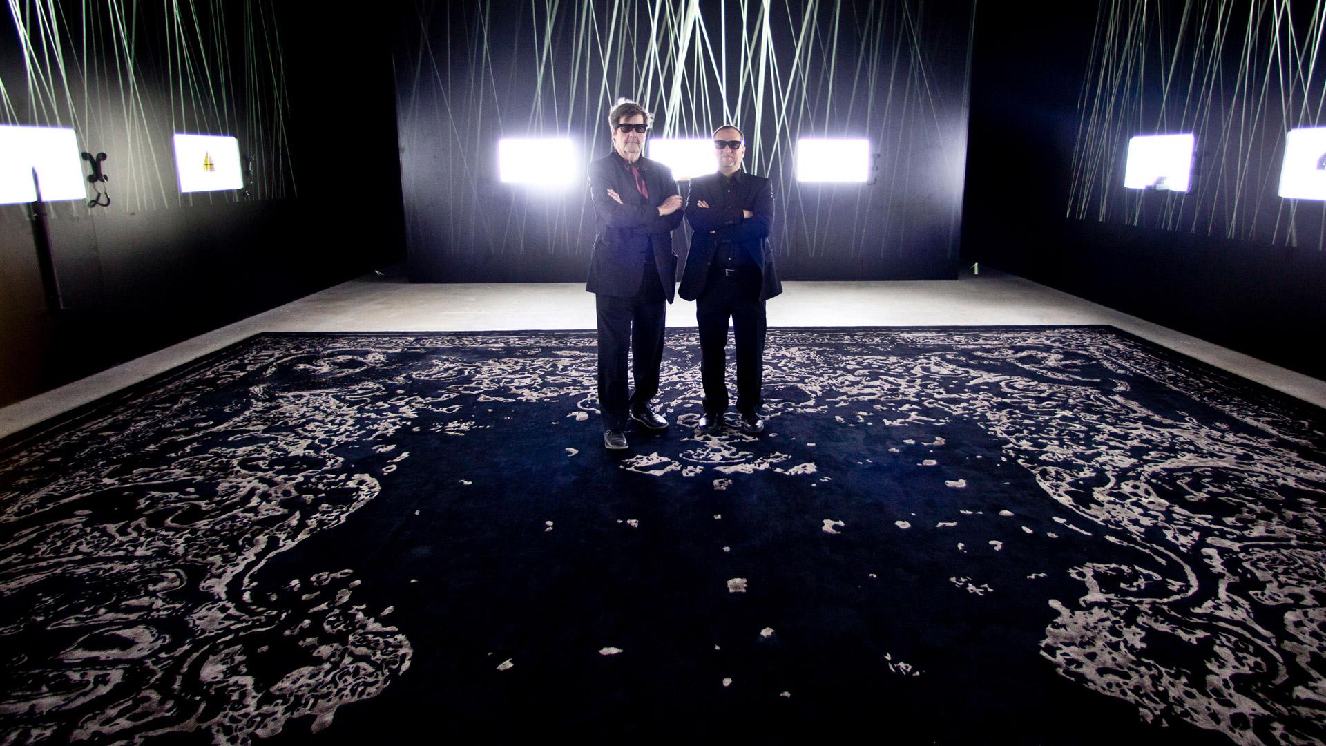 Art expert Florian Hufnagel stands next to designer Michael Keller in the exhibition room of the Schaustelle.
