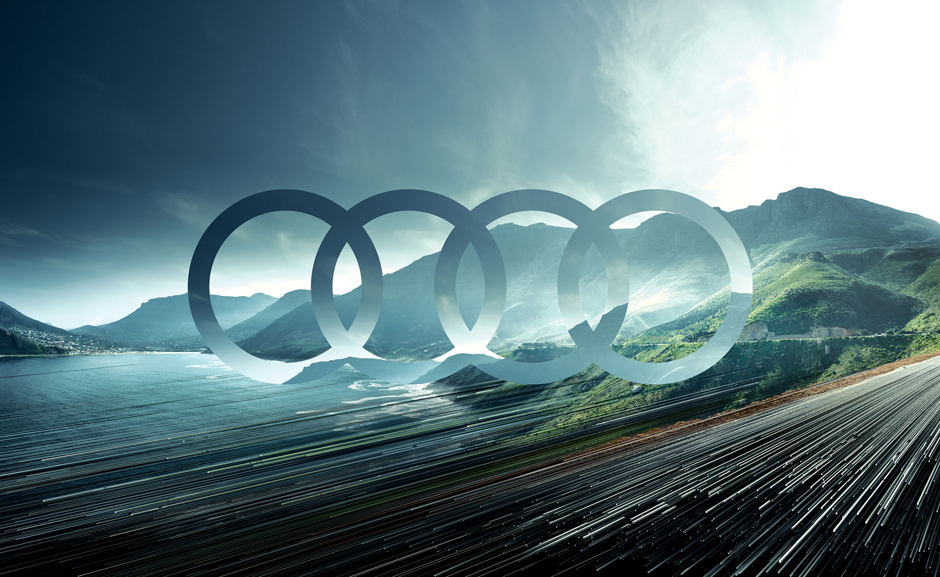 The new Audi logo, which adapts to the mountain scenery in the background.