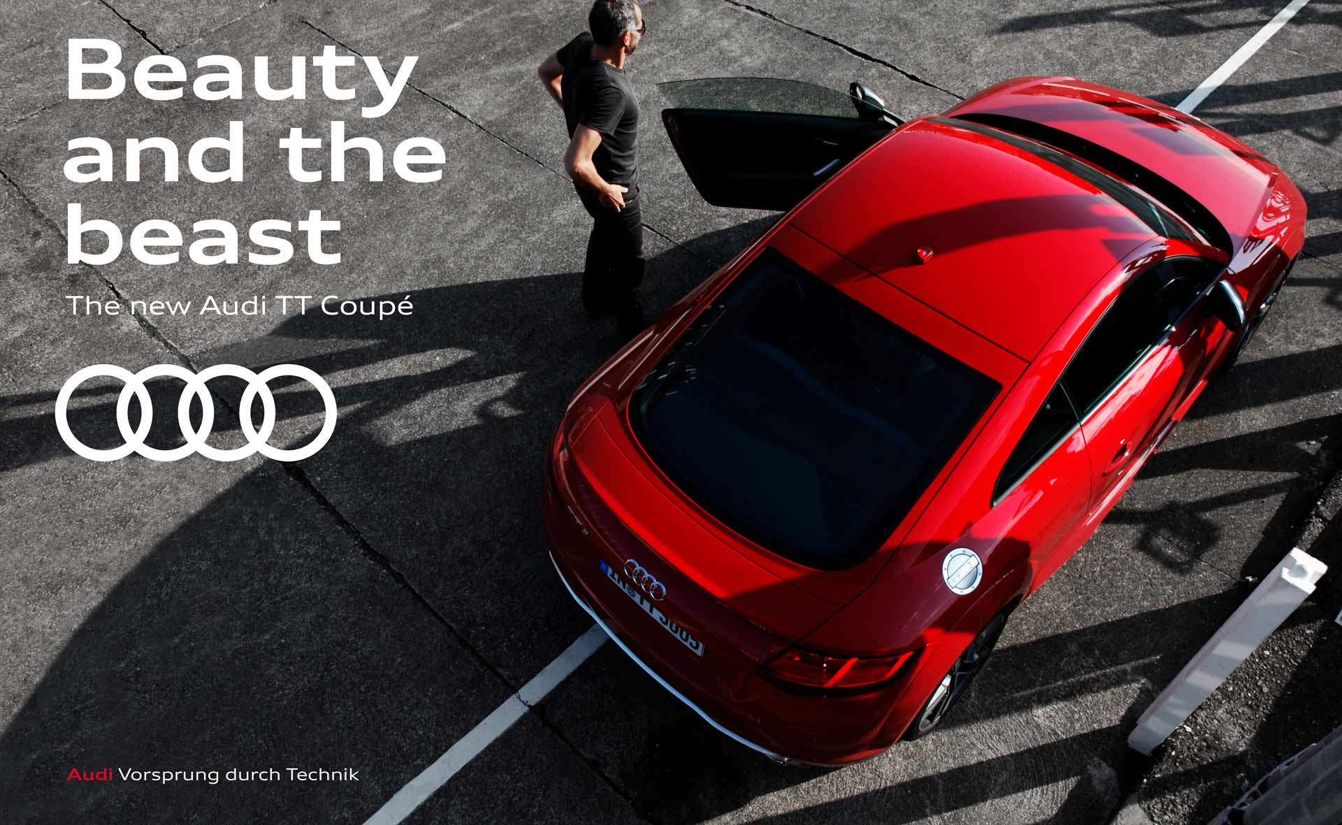 The picture shows an advertisement for the new Audi TT Coupé. A man stands next to a red model. It says: Beauty and the beast. The new Audi TT Coupé.