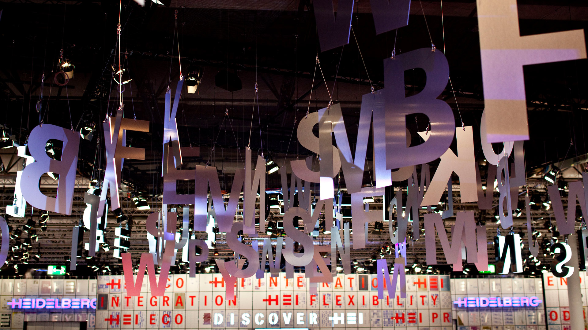 Large silver letters hang from the ceiling.