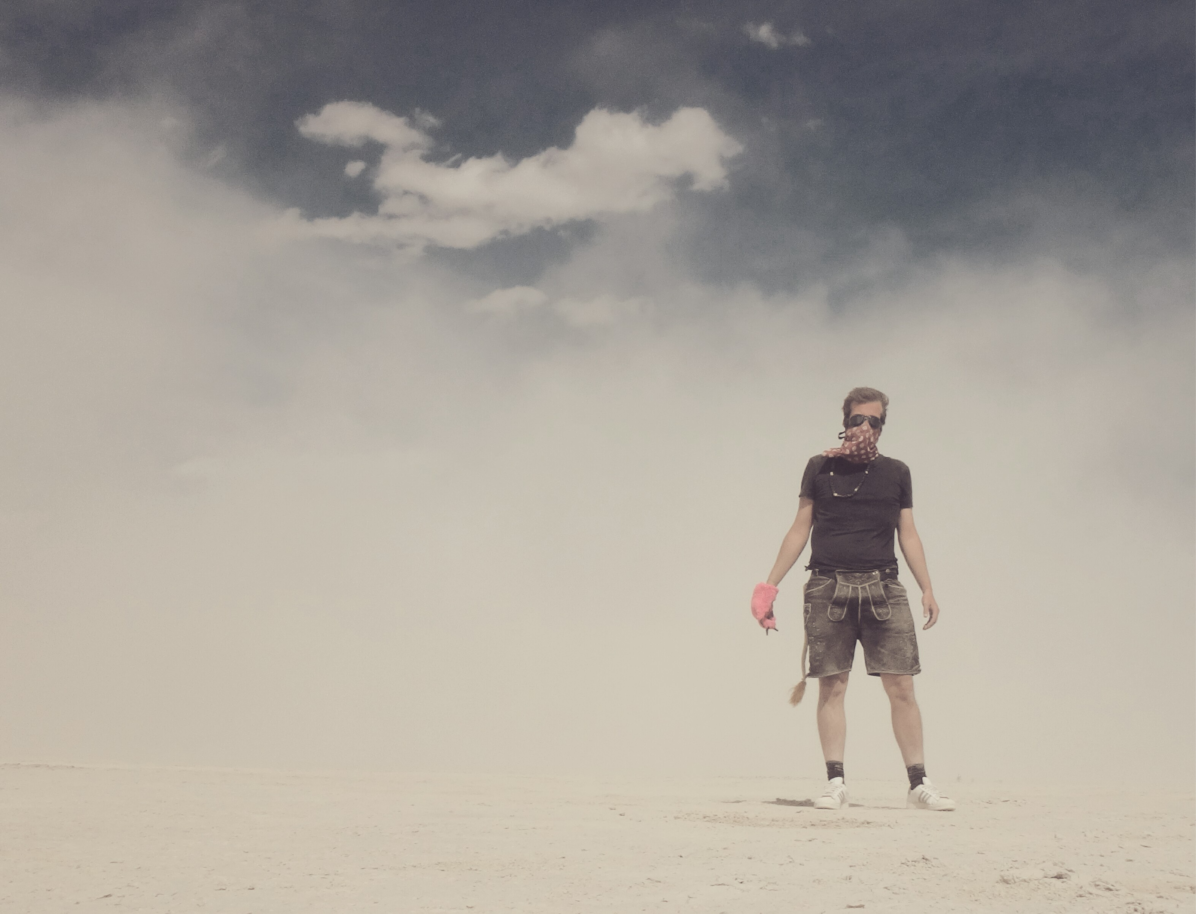Moritz is standing in the middle of the desert in Lederhosen at the Burning Man.