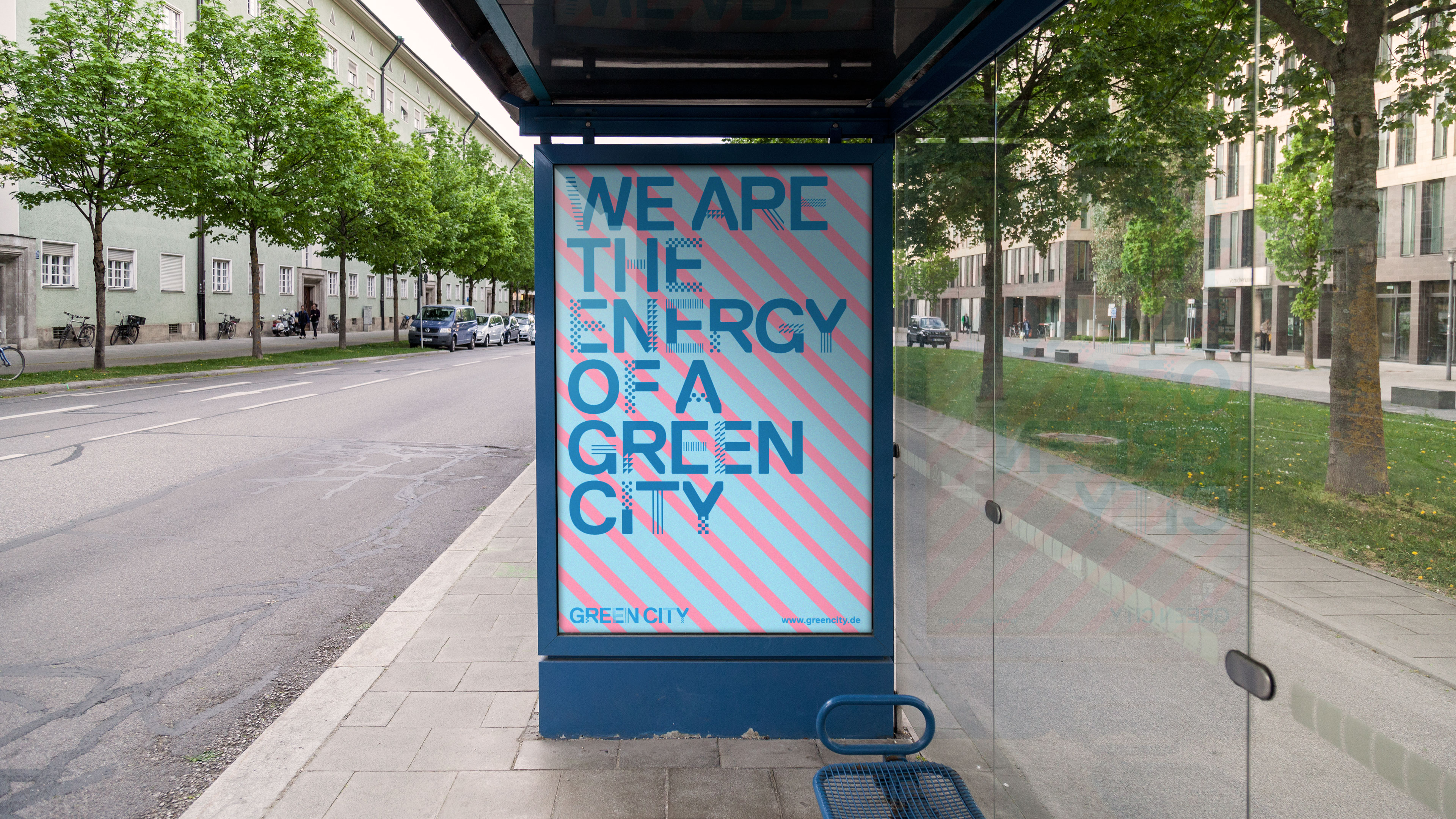 A new Green City poster hangs at a bus stop.
